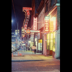 Vancouver's Hastings Street circa late 1980s, looking west from Main Street, sidewalk night shot with neon signs